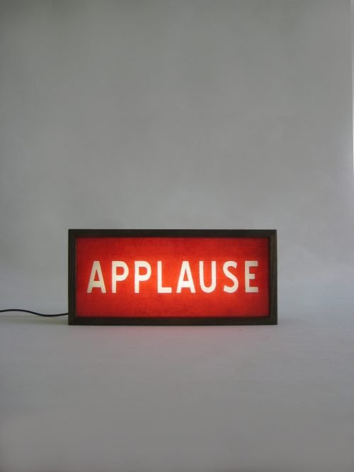 red applause sign wooden lightbox