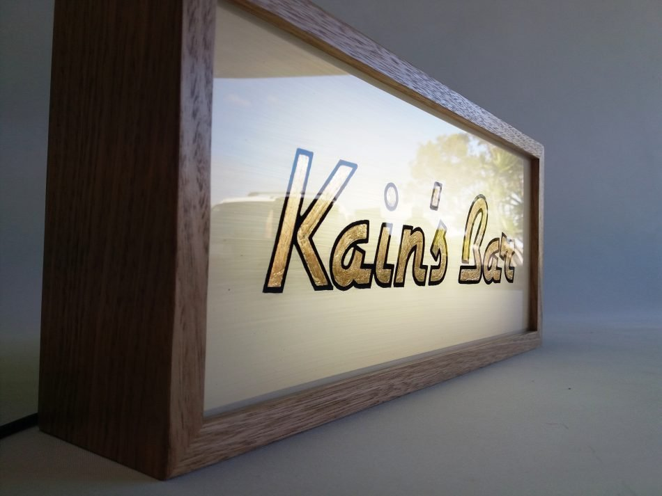 Gold Leaf Gilded Sign in Lightbox